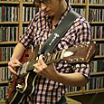 Lu on guitar and radio